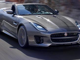 Ein grauer Jaguar F-Type Cabrio fährt auf einer Passtraße