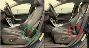 Bildlicher Hinweis zum Umgang mit der Gurtschnalle im Zusammenhang mit dem Volvo-Rückruf R10029